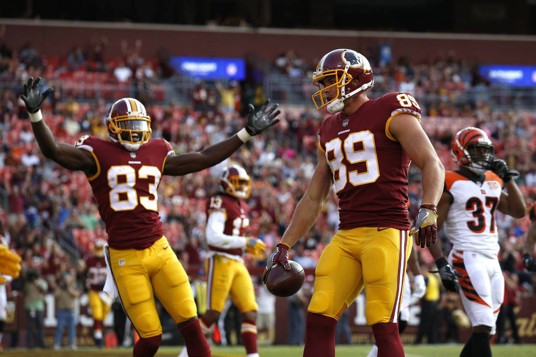 Washington Redskins tight end Derek Carrier (89) celebrates his touchdown with teammates in the second half of a preseason NFL football game against the Cincinnati Bengals, Sunday, Aug. 27, 2017,  ...