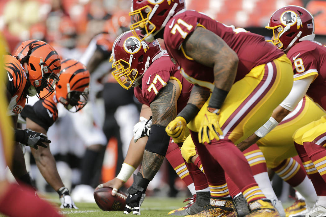 Washington Redskins offensive line at the line scrimmage during a preseason NFL football game between the Cincinnati Bengals and Washington Redskins, Sunday, Aug. 27, 2017, in Landover, Md. (AP Ph ...