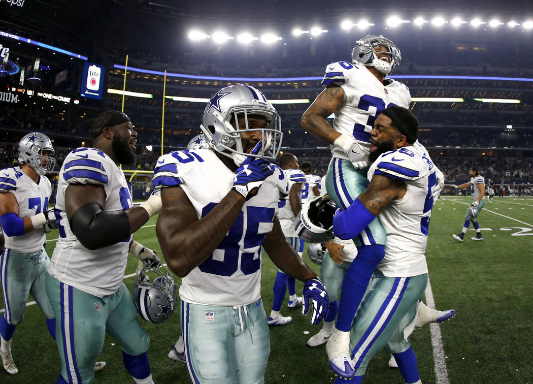 Dallas Cowboys wide receiver Noah Brown (85) celebrates as defensive end Damontre Moore, right, lifts safety Robert Blanton (36) after a defensive stop against the Oakland Raiders late in the seco ...