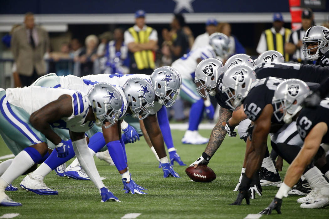 The Dallas Cowboys and Oakland Raiders line up against each other in the second half of a preseason NFL football game, Saturday, Aug. 26, 2017, in Arlington, Texas. (AP Photo/Michael Ainsworth)