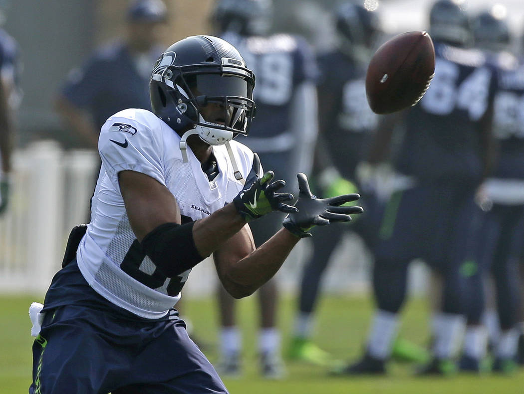 Seattle Seahawks wide receiver Doug Baldwin makes a catch during an NFL football training camp, Thursday, Aug. 10, 2017, in Renton, Wash. (AP Photo/Ted S. Warren)