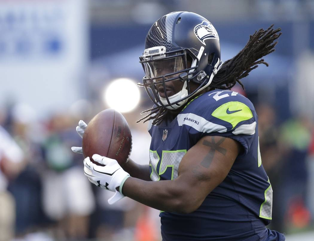 Seattle Seahawks running back Eddie Lacy makes a catch during warmups before an NFL football preseason game against the Kansas City Chiefs, Friday, Aug. 25, 2017, in Seattle. (AP Photo/Elaine Thom ...