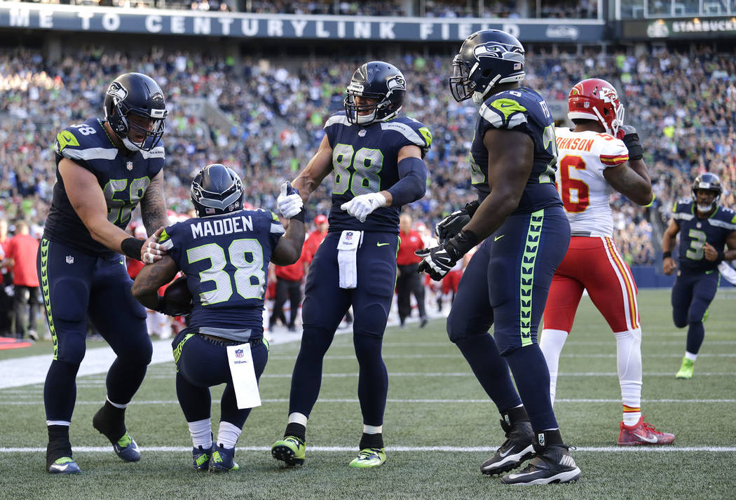 Seattle Seahawks fullback Tre Madden (38) is greeted by teammates D.J. Alexander, left, Jimmy Graham (88) and Germain Ifedi after Madden scored a touchdown against the Kansas City Chiefs during th ...