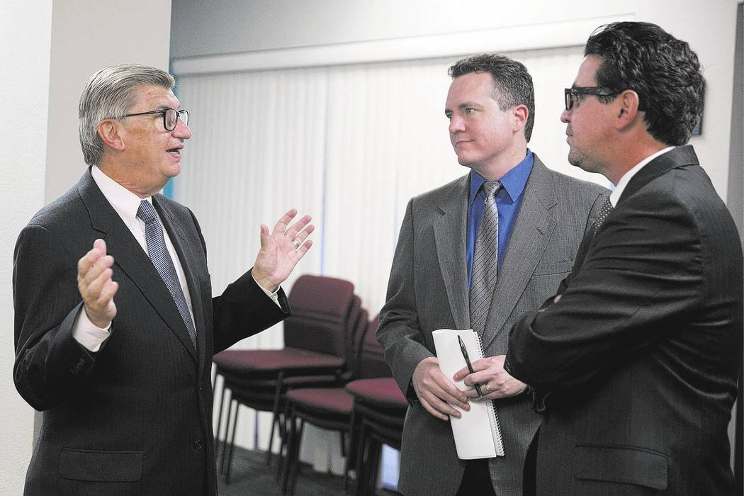 Larry Matheis, CEO of the Nevada Medical Center, from left, speaks with Brian Haynes and Jeremy Aguero of Applied Analytics after the launch of Nevada Medical Center's Nevada Healthcare Report Car ...