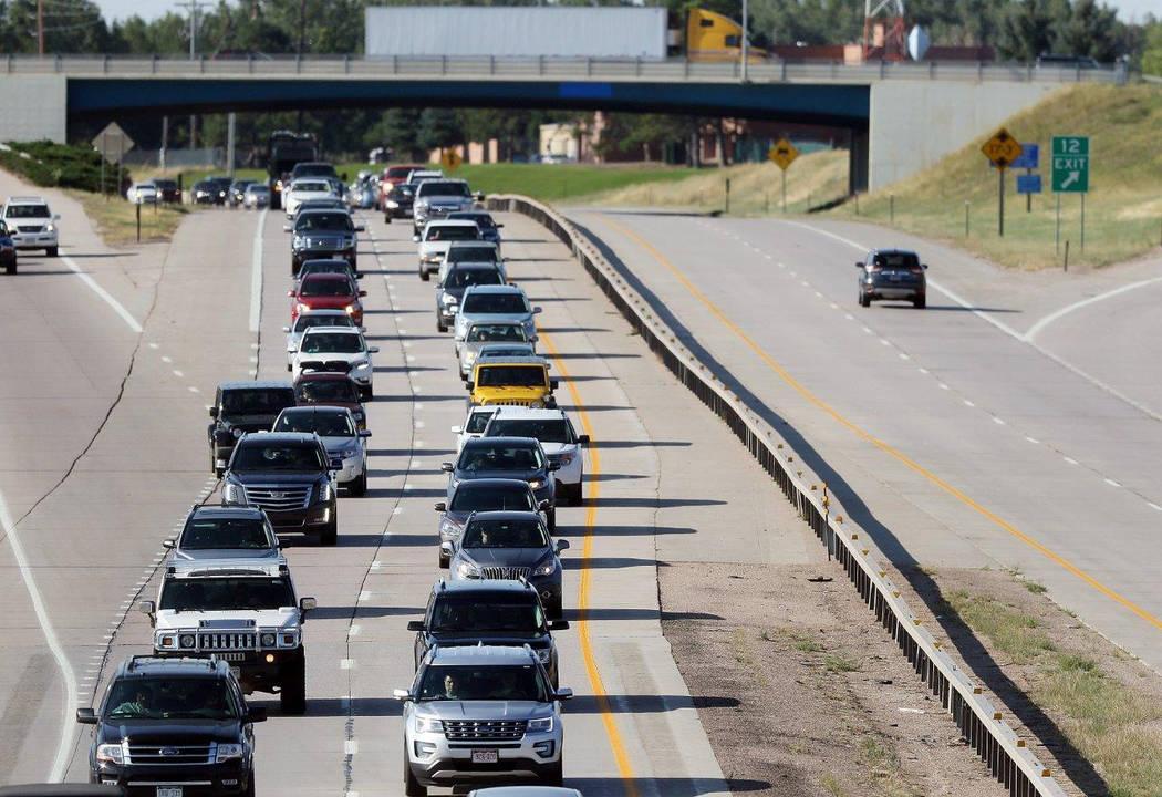Heavy traffic moving slowly along Interstate 80 in Cheyenne, Wyo., on Aug. 21. (Blaine McCartney/The Wyoming Tribune Eagle via AP)
