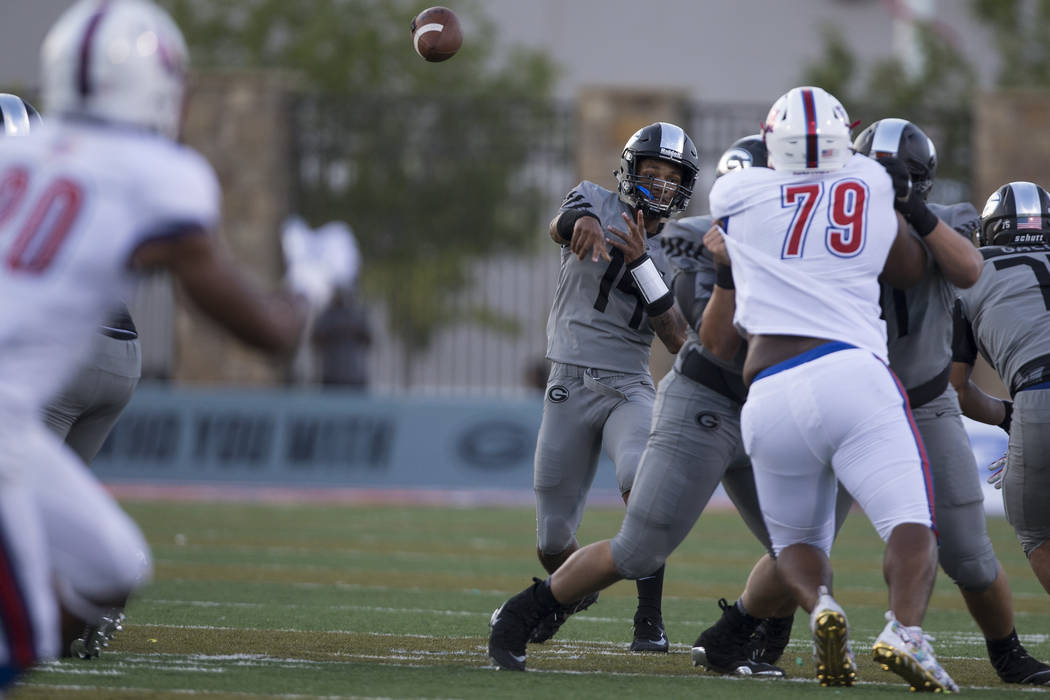 Bishop Gorman's Dorian Thompson-Robinson (14) throws a pass against DeMatha Catholic at Bishop Gorman High School in Las Vegas, on Friday, Aug. 25, 2017. Gorman won 35-23. Erik Verduzco Las Vegas  ...