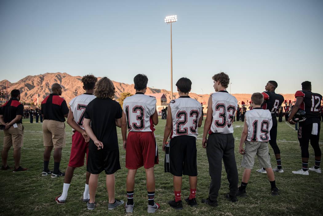 Football waterboys listen to the National Anthem before game at Las Vegas High School on Friday, Aug. 25, 2017, in Las Vegas. Morgan Lieberman Las Vegas Review-Journal