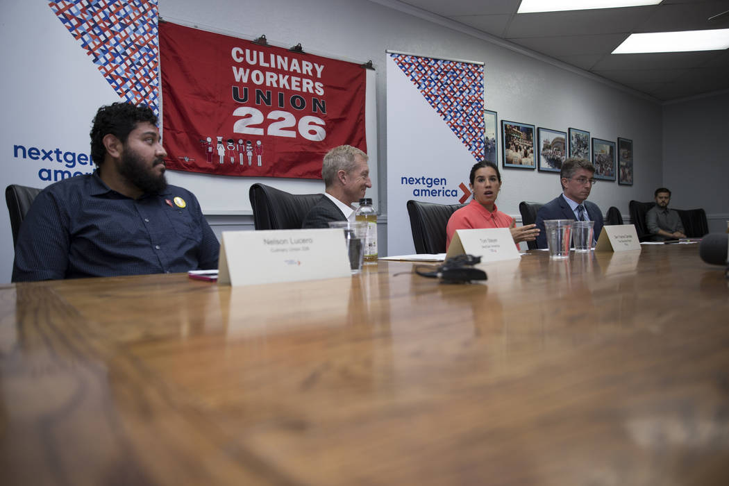 Nelson Lucero, from left, culinary union member, Tom Steyer, founder of NextGen America, State Sen. Yvanna Cancela and Michael Kagan, professor of Law and Director of the UNLV Immigration Clinic,  ...