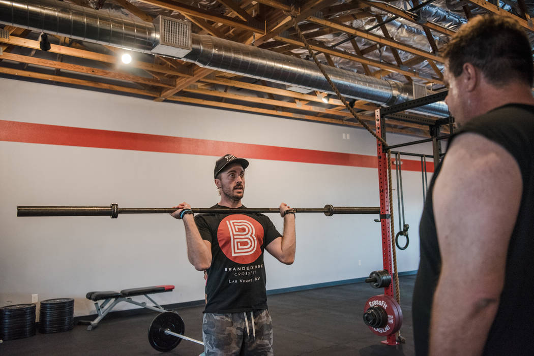 Founder Nick McCombs shows Gary Bartusch a dead lift exercise at Branded One Cross Fit on Thursday, Aug. 25, 2017, in Las Vegas. Morgan Lieberman Las Vegas Review-Journal