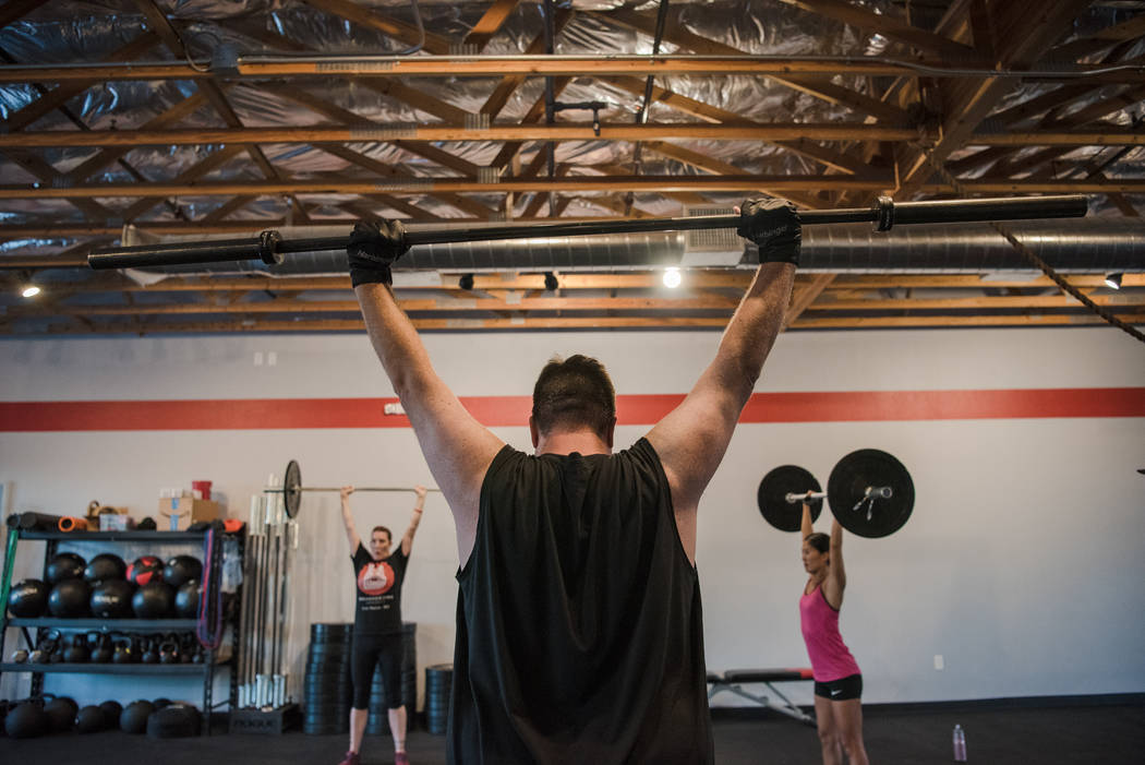 Gary Bartusch, center, trains with Elizabeth Higgins, left, and Leah Elmquist at Branded One Cross Fit on Thursday, Aug. 25, 2017, in Las Vegas. Morgan Lieberman Las Vegas Review-Journal
