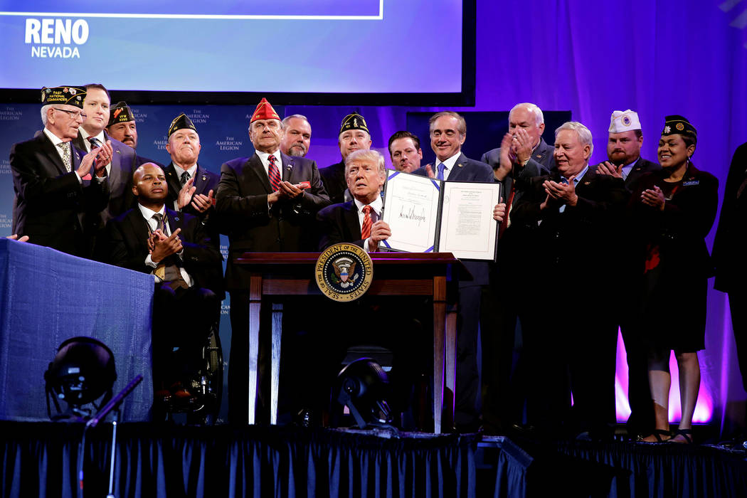 U.S. President Donald Trump signs the Veterans Appeals Improvement and Modernization Act in Reno, Nevada, U.S., August 23, 2017. Joshua Roberts Reuters