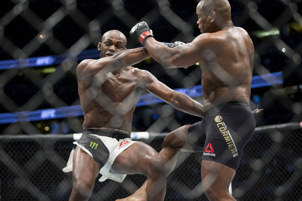Jon Jones, left, battles Daniel Cormier in the light heavyweight title bout during UFC 214 at the Honda Center in Anaheim, California, on Saturday, July 29, 2017. Jones won by knockout. Erik Verdu ...