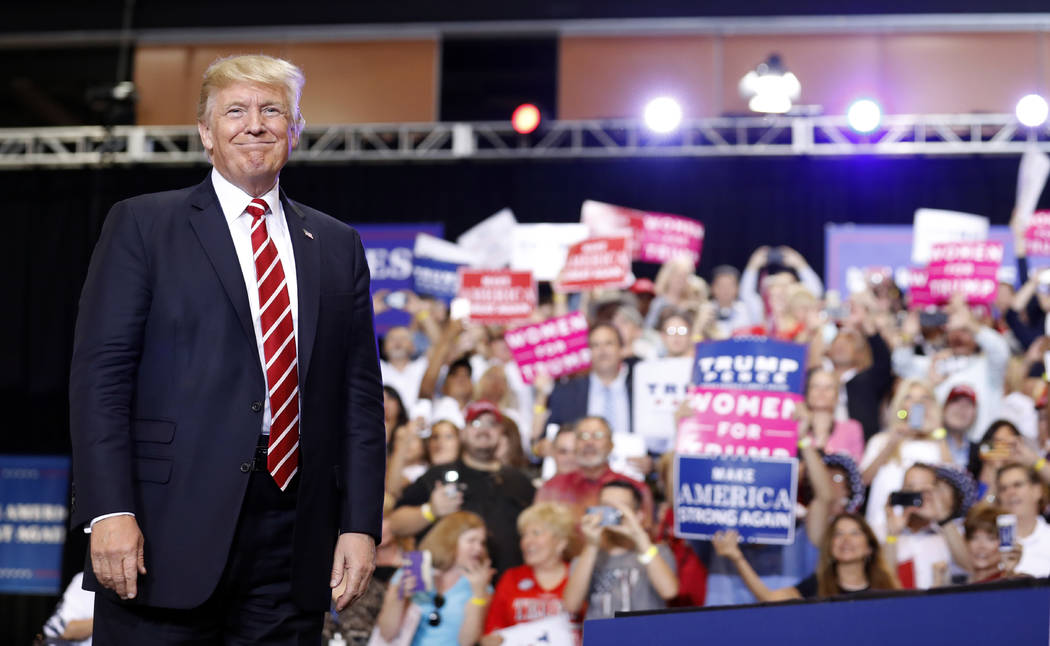 President Donald Trump stands before speaking at a rally at the Phoenix Convention Center, Tuesday, Aug. 22, 2017, in Phoenix. (AP Photo/Alex Brandon)