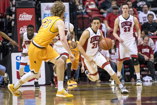UNLV guard Austin Starr (20) looks to get past Wyoming guard Jason McManamen (23) during the second half at the Thomas & Mack Center in Las Vegas on Saturday, Feb. 27, 2016. UNLV won 79-74. Jo ...
