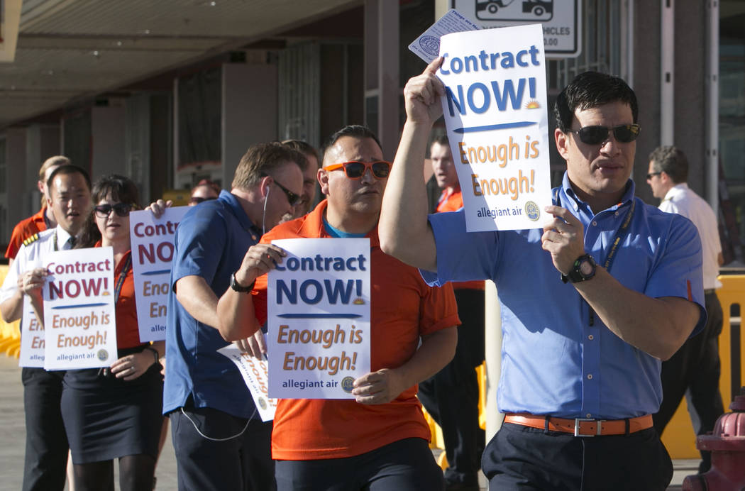 Allegiant Air flight attendants picket in front of McCarran International Airport to highlight union efforts to settle a six-year contract fight on Wednesday, Aug. 23, 2017, in Las Vegas. (Bizuaye ...