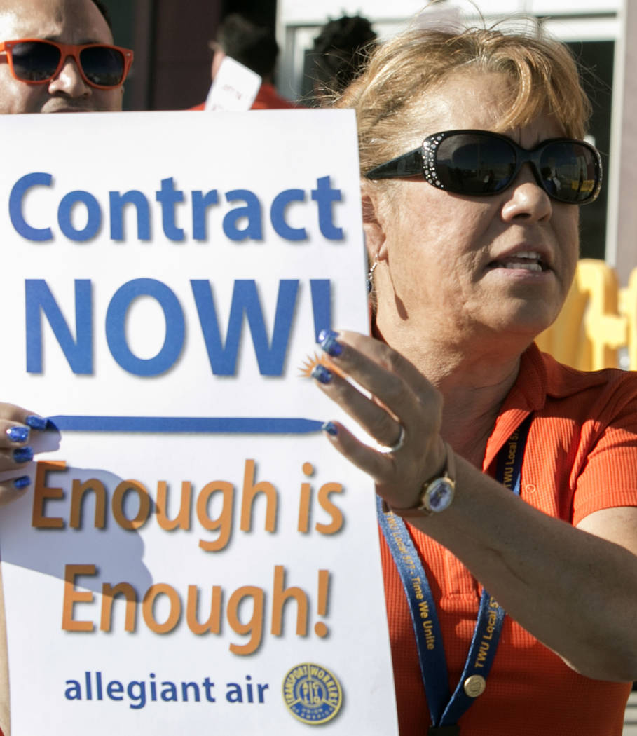 Allegiant Air flight attendant Kim Wood pickets in front of McCarran International Airport to highlight union efforts to settle a six-year contract fight on Wednesday, Aug. 23, 2017, in Las Vegas. ...