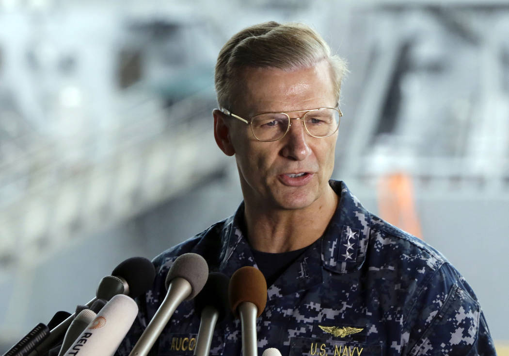 In this June 18, 2017, file photo, U.S. Navy Vice Adm. Joseph Aucoin, Commander of the U.S. 7th Fleet, speaks during a press conference, with damaged USS Fitzgerald as background at the U.S. Naval ...