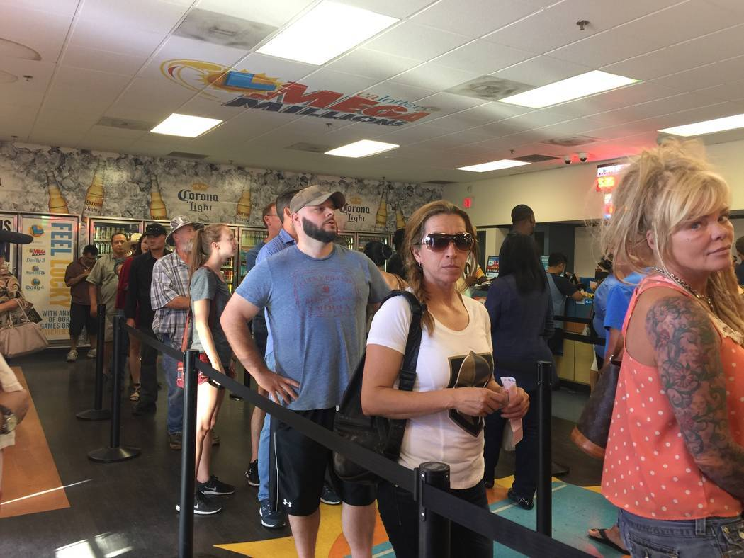 Patrons line up Friday to purchase Powerball tickets at the Primm Valley Lotto Store. (Briana Erickson/Las Vegas Review-Journal)