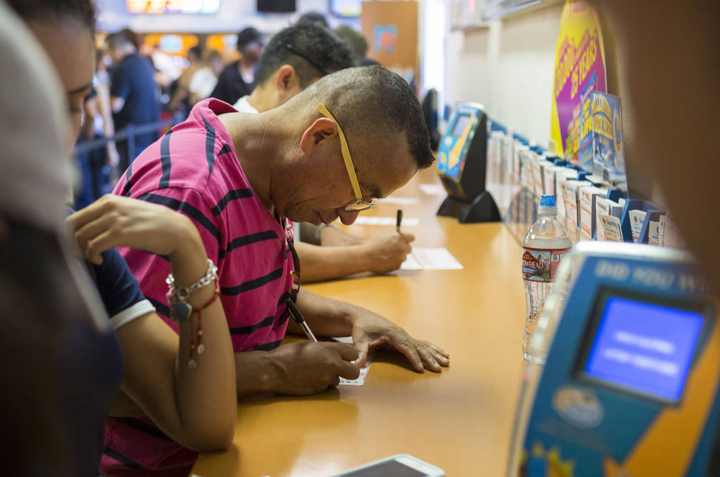 Jose Guerra fills out numbers on Powerball tickets at the Primm Valley Lotto Store, Wednesday, Aug. 16, 2017. (Elizabeth Brumley/Las Vegas Review-Journal)