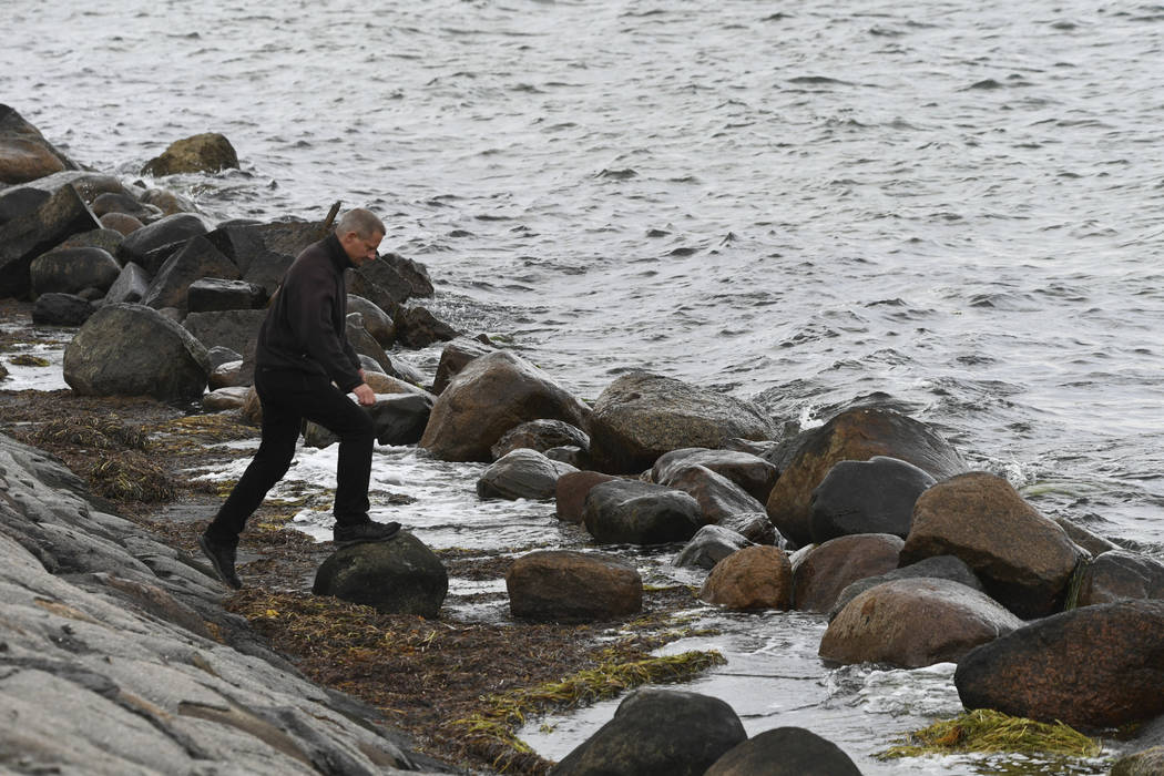 A police officer attends the south coast of the isle of Amager, near Copenhagen, Denmark, Monday Aug. 21, 2017. The body of a woman has been found in the Baltic Sea near where a missing Swedish jo ...