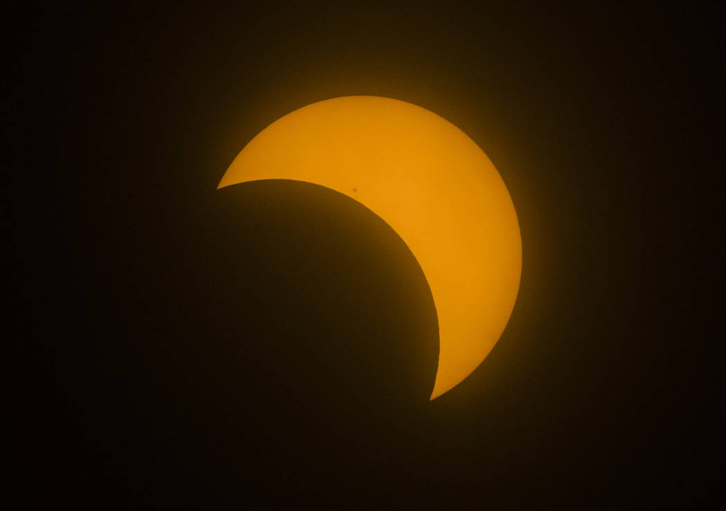 The moon passes by the sun during a partial solar eclipse in Las Vegas on Monday, Aug. 21, 2017. (Chase Stevens Las Vegas/Review-Journal) @csstevensphoto