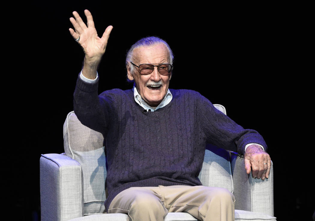 """Comic book writer Stan Lee waves to the audience after being introduced onstage at the """"Extraordinary: Stan Lee"""" tribute event at the Saban Theatre on Tuesday, Aug. 22, 2017, in Beverly Hills, Cal ..."""