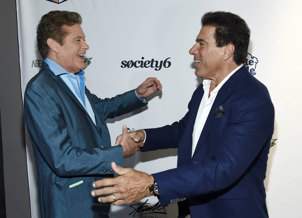 """Actors David Hasselhoff, left, and Lou Ferrigno greet each other on the red carpet at the """"Extraordinary: Stan Lee"""" tribute event at the Saban Theatre on Tuesday, Aug. 22, 2017,  ..."""