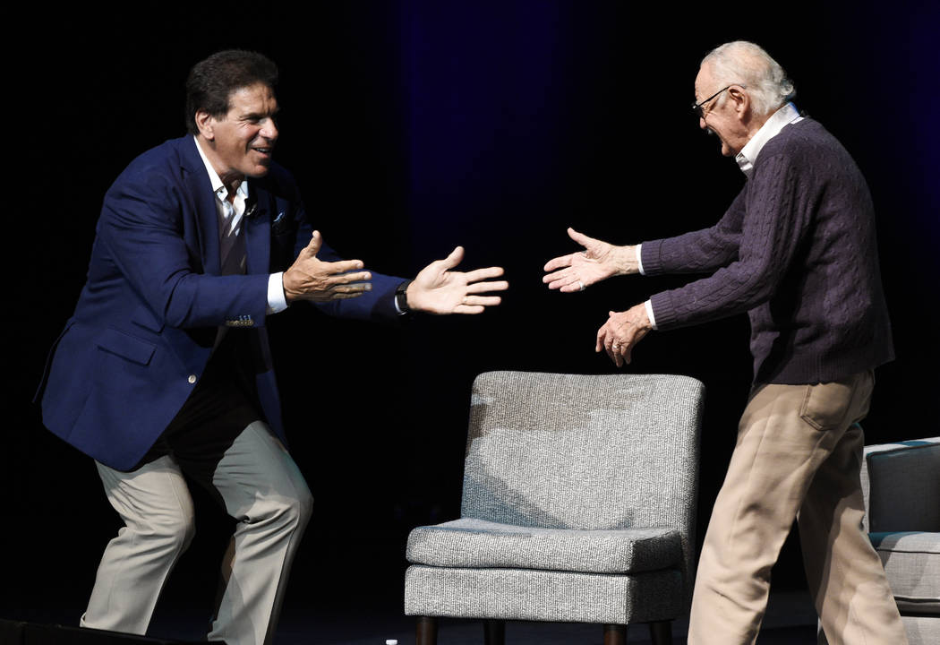 """Comic book writer Stan Lee, right, greets actor Lou Ferrigno onstage at the """"Extraordinary: Stan Lee"""" tribute event at the Saban Theatre on Tuesday, Aug. 22, 2017, in Beverly Hil ..."""
