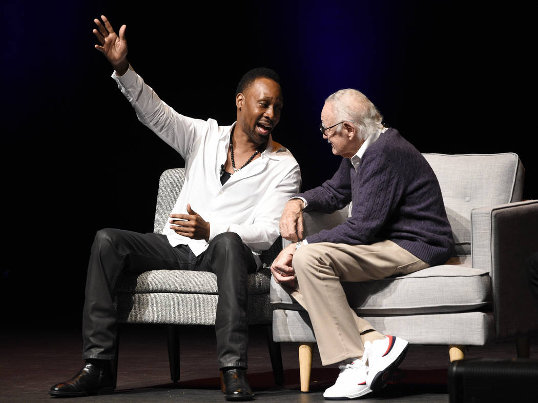 """Musician RZA, left, mingles onstage with comic book writer Stan Lee at the """"Extraordinary: Stan Lee"""" tribute event at the Saban Theatre on Tuesday, Aug. 22, 2017, in Beverly Hill ..."""