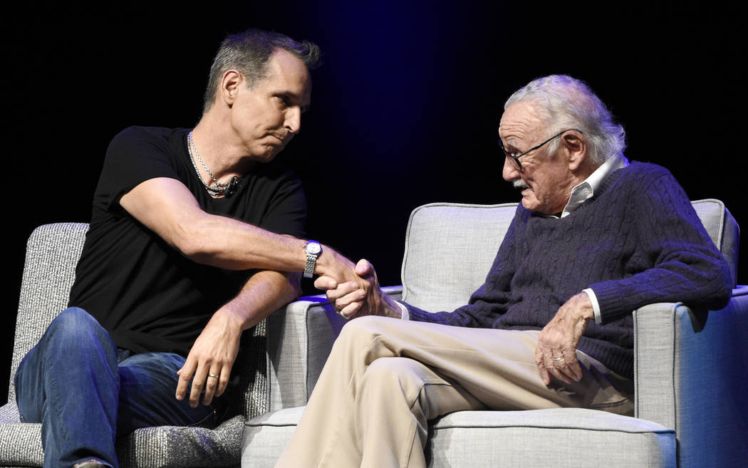 """Comic book artist Todd McFarlane, left, greets comic book writer Stan Lee onstage at the """"Extraordinary: Stan Lee"""" tribute event at the Saban Theatre on Tuesday, Aug. 22, 2017, i ..."""