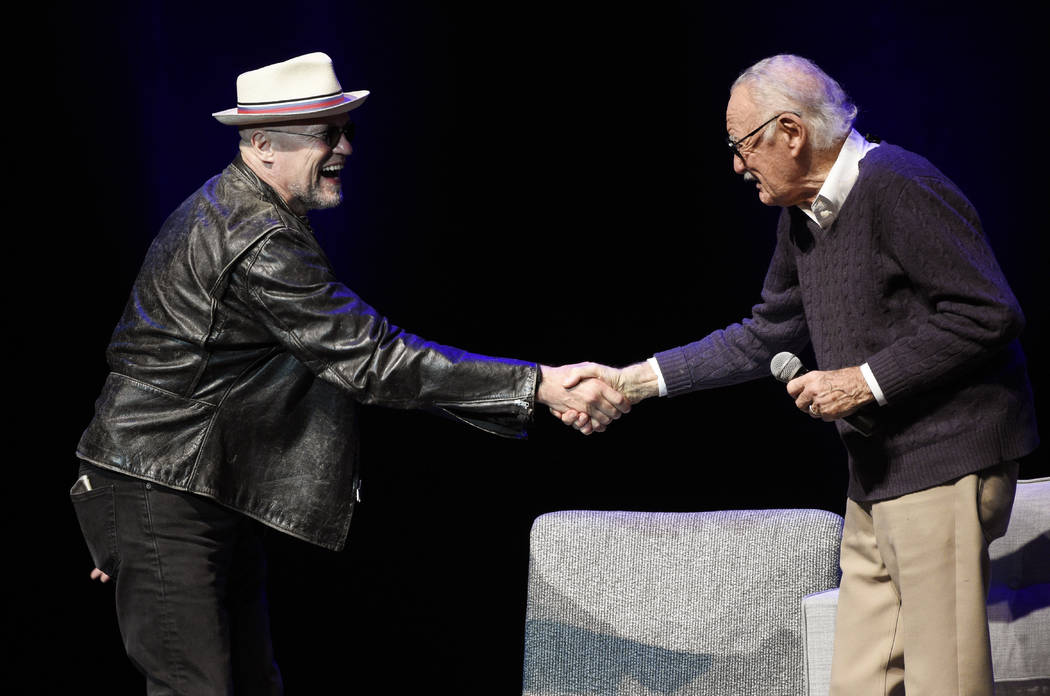 """Comic book writer Stan Lee, right, greets actor Michael Rooker onstage at the """"Extraordinary: Stan Lee"""" tribute event at the Saban Theatre on Tuesday, Aug. 22, 2017, in Beverly H ..."""
