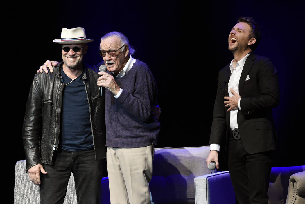 """Host Chris Hardwick, right, laughs as comic book writer Stan Lee, center, and actor Michael Rooker mingle onstage at the """"Extraordinary: Stan Lee"""" tribute event at the Saban Thea ..."""