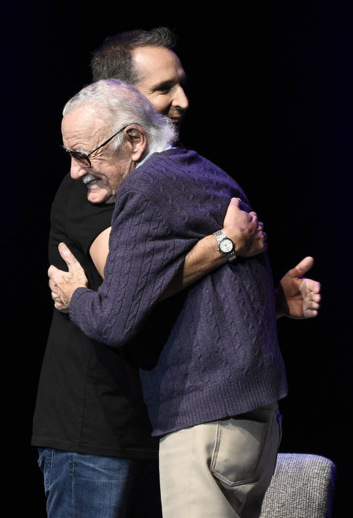 """Comic book writer Stan Lee, facing left, embraces comic book artist Todd McFarlane onstage at the """"Extraordinary: Stan Lee"""" tribute event at the Saban Theatre on Tuesday, Aug. 22 ..."""