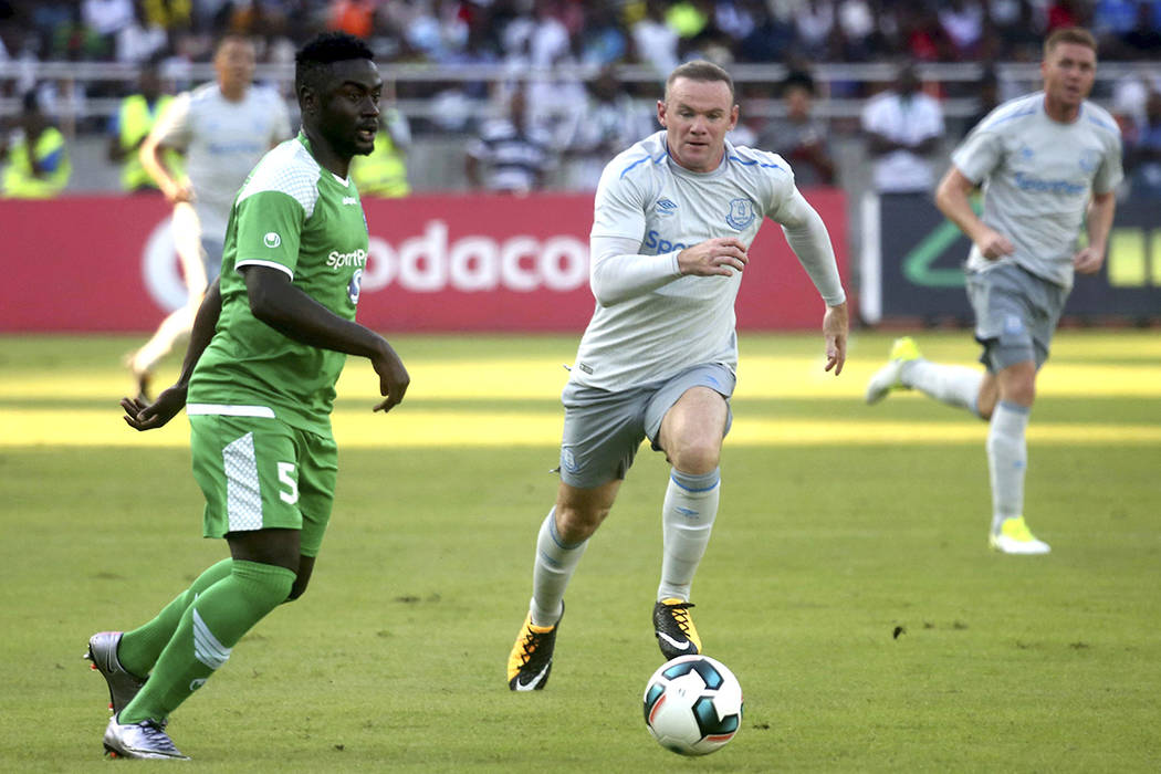 Wayne Rooney, shown un action on  July 13 against Kenya, retired from international play on Wednesday. (Khalfan Said/AP)
