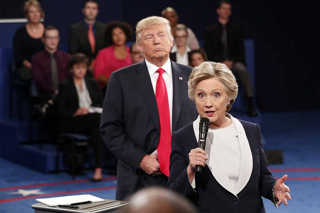 In this Oct. 9, 2016 file photo, Democratic presidential nominee Hillary Clinton, right, speaks as Republican presidential nominee Donald Trump listens during the second presidential debate at Was ...