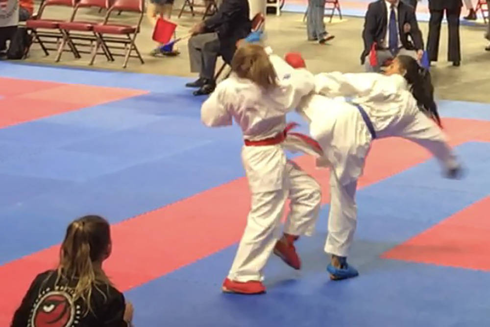 Gia Mazza, right, lands a kick during the 2017 USA Karate Nationals, held mid-July in Greenville, South Carolina. She was the winner for her age group and is set to compete in the World Karate Fed ...