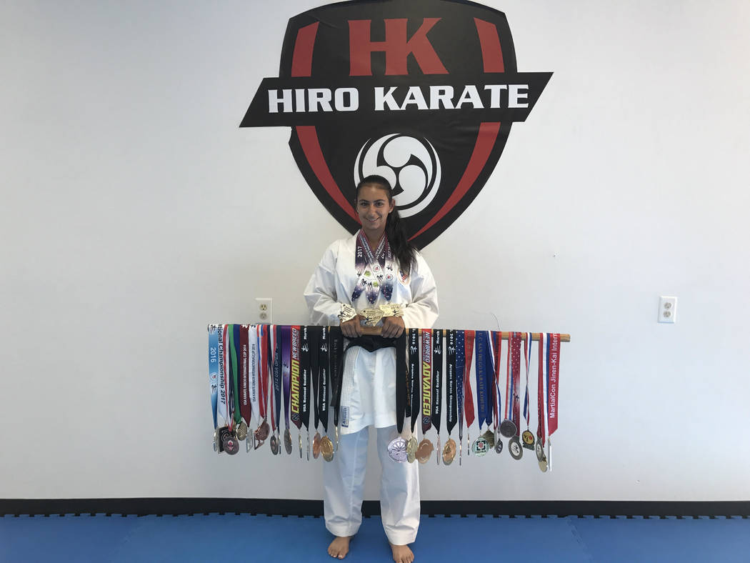 """Gianella """"Gia"""" Mazza poses with her ribbons in this undated photo from 2017. The Las Vegas teen has been learning karate under Hiroshi Allen, seven-time national champion, but after she won a  ..."""