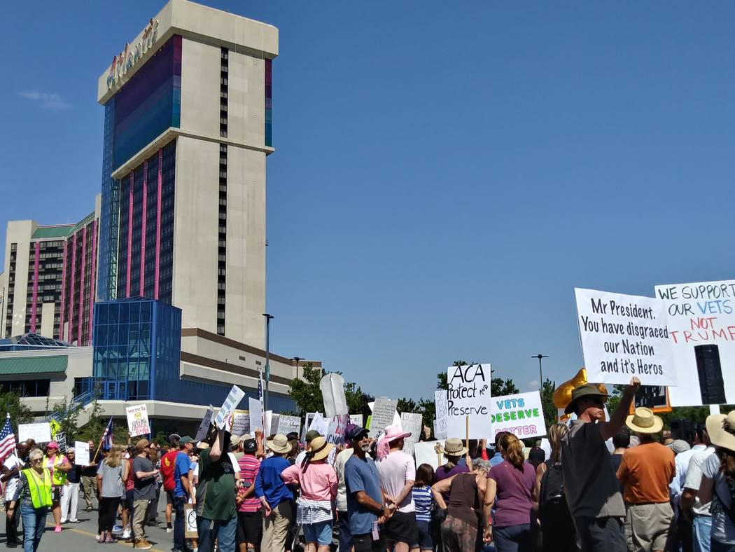 Protesters against President Donald Trump make their voice heard Wednesday, Aug. 23, 2017, outside the Reno-Sparks Convention Center in Reno, where Trump spoke during the American Legion's nationa ...