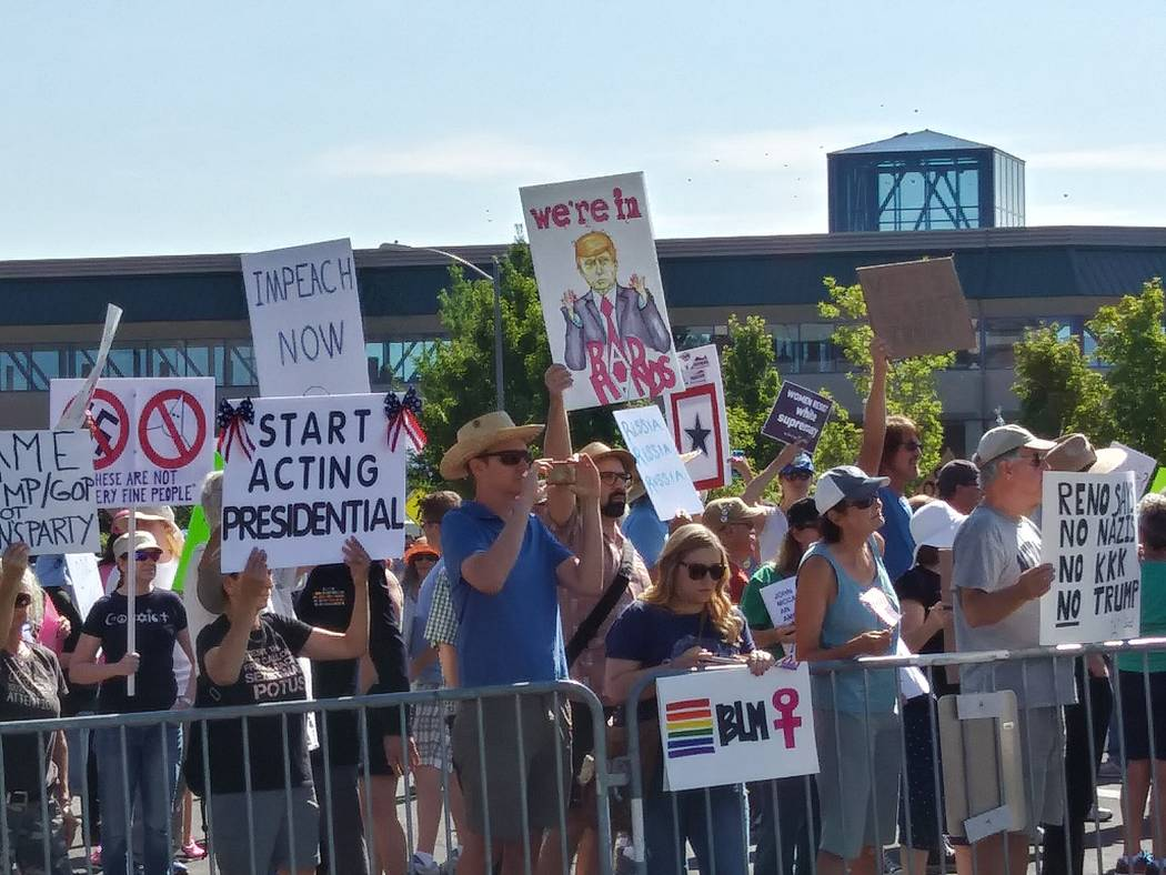 Protesters against President Donald Trump make their voice heard Wednesday, Aug. 23, 2017, outside the Reno-Sparks Convention Center in Reno, where Trump spoke at the American Legion's national co ...