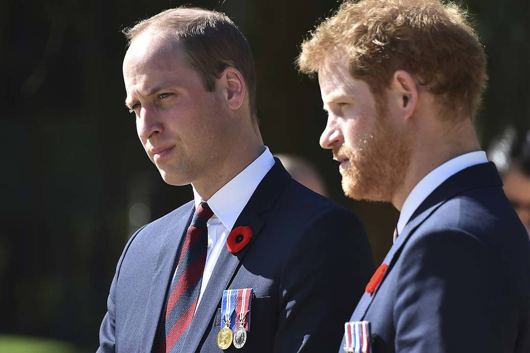 In an April 9, 2017, file photo, Britain's Prince William, left, and Britain's Prince Harry arrive at the Canadian National Vimy Memorial in Vimy, near Arras, northern France. Princes William and  ...