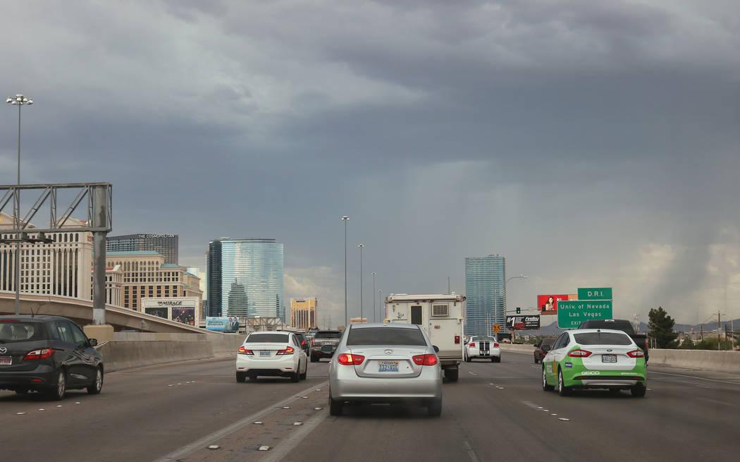Storm clouds gather over downtown Las Vegas near Interstate 15, Wednesday, Aug. 23, 2017. (Gabriella Benavidez/Las Vegas Review-Journal) @latina_ish