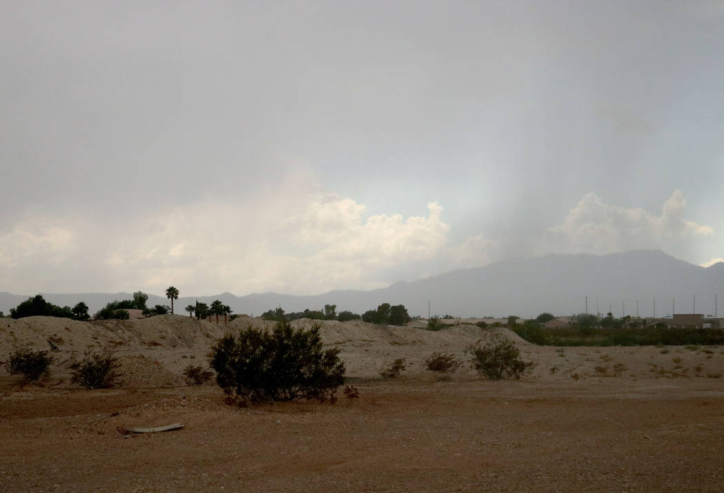 A far off downpour of rain seen from Dean Martin Drive near the Silverton hotel-casino, Wednesday, Aug. 23, 2017. (Gabriella Benavidez/Las Vegas Review-Journal) @latina_ish