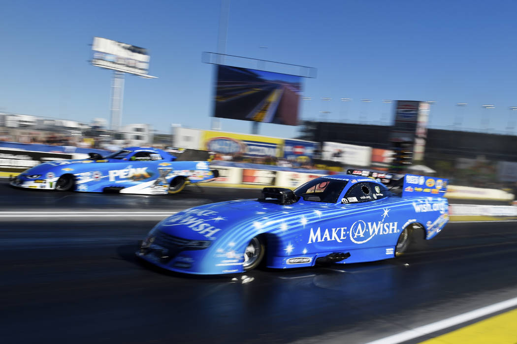 Funny Car drivers Tommy Johnson Jr., right, beats John Force during the 18th annual DENSO Spark Plugs NHRA Nationals Sunday, April 2, 2017, at The Strip at the Las Vegas Motor Speedway. Sam Morris ...