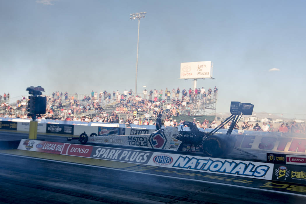 Top Fuel driver Antron Brown prepares for his final race of the day at DENSO Spark Plugs NHRA Nationals at The Strip at Las Vegas Motor Speedway on Sunday, April 2, 2017, in Las Vegas. Brown was t ...