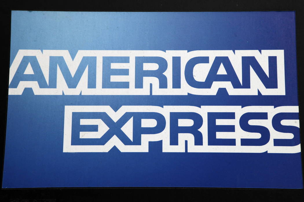 A sign for American Express outside a New York business on Jan. 21, 2015. (AP Photo/Mark Lennihan, File)