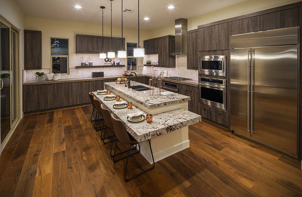 Among the hundreds of floor plans currently offered through builder-partners of the Nevada Builder Trade In contingency program is the two-story Vernazza design that features a gourmet island kitc ...