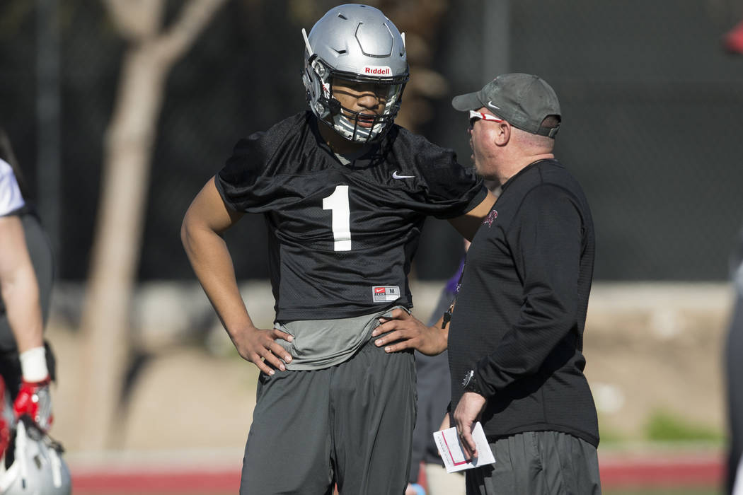 UNLV's quarterback Armani Rogers (1), left, talks to head football coach Tony Sanchez during a team practice at Rebel Park in UNLV on Wednesday, March 1, 2017, in Las Vegas. (Erik Verduzco/Las Veg ...