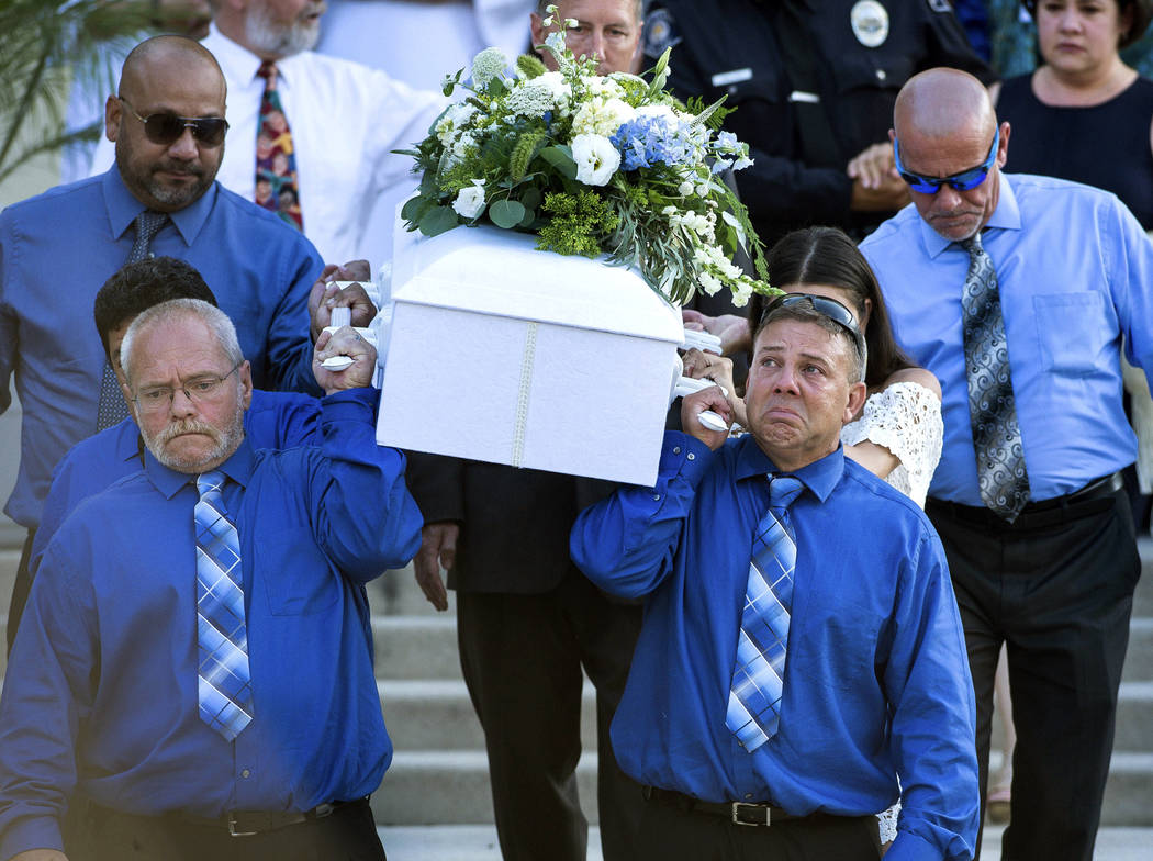 Pallbearers carry the casket of Aramazd Andressian Jr. at his funeral at Holy Family Roman Catholic Church in South Pasadena, Calif. on July 18, 2017. (Sarah Reingewirtz /Los Angeles Daily News vi ...