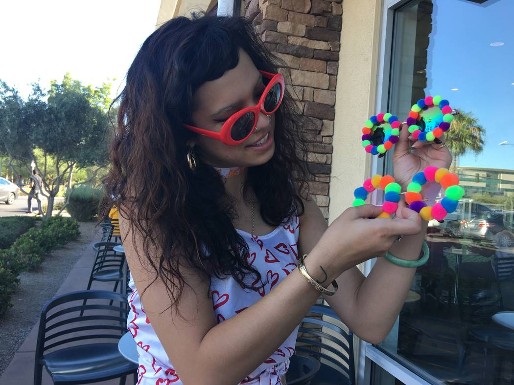 Malia Yanos, 23, of the northwest valley showing off handmade sunglasses that she made for her brand Trippy Neon on August 22, 2017. (Kailyn Brown/ View) @KailynHype