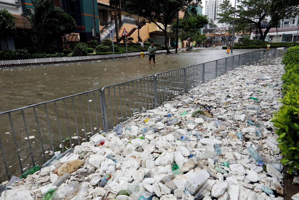 Rubbish and styrofoam are being washed up onto the pavement as Typhoon Hato hits Hong Kong, China August 23, 2017. Tyrone Siu/Reuters